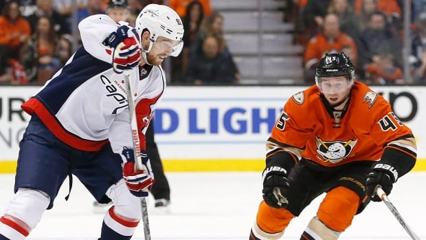 The Capitals' Evgeny Kuznetsov, left, and Ducks' Sami Vatanen vie for the puck in the second period of Monday night's NHL game in Anaheim, Calif. Kuznetsov had an assist in Washington's 2-1 shootout victory, its sixth win in a row over the Ducks, who had their 11-game win streak halted.