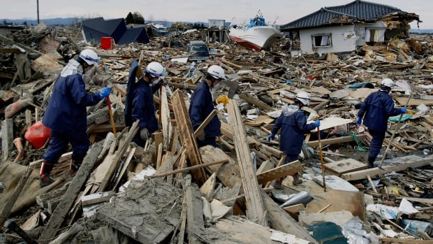 Recovery workers look through tsunami-destroyed homes in Natori, Japan in this 2011 file photo. The March 11, 2011 earthquake off Japan's northeast coast was one of the strongest in recorded history.