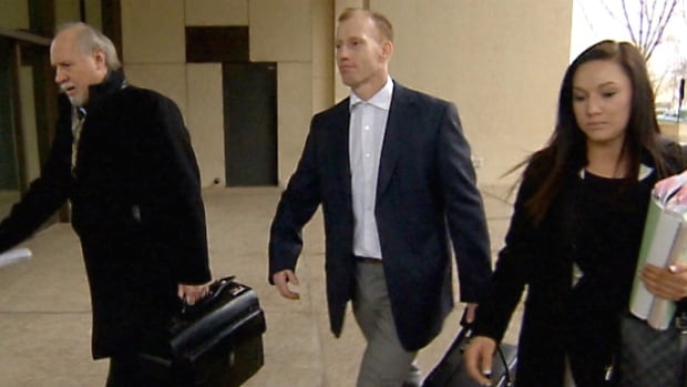 Travis Vader, centre, and his lawyer, Brian Beresh, arriving at the Edmonton courthouse Tuesday morning for the beginning of a murder trial expected to last six weeks.