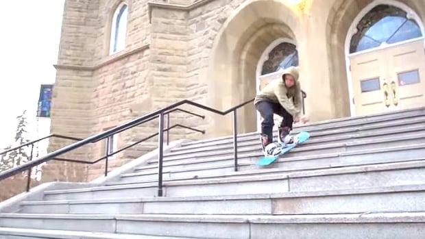 Kael Hill rides his board down the stairs in front of Grace Presbyterian Church in Calgary.