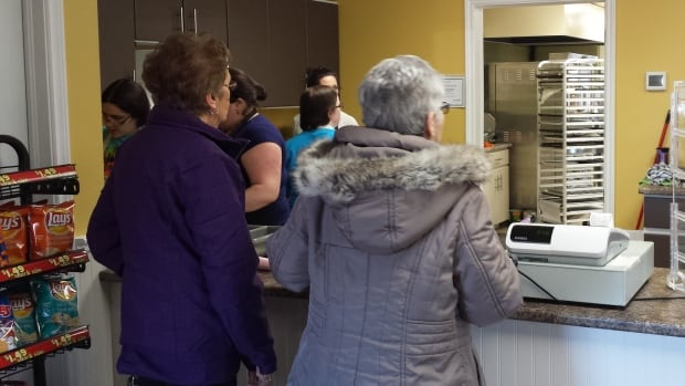 Customers line up at the Maple House Bakery and Cafe in O'Leary.