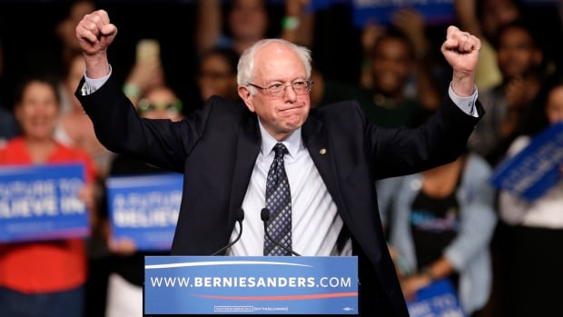 Democratic presidential candidate, Sen. Bernie Sanders, I-Vt. acknowledges his supporters on arrival at a campaign rally in Miami on Tuesday, about two hours before Michigan was projected to fall his way.