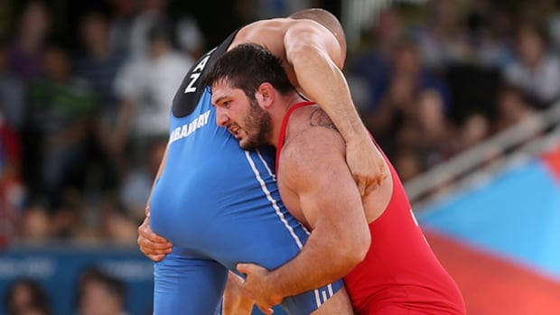 Georgia's Olympic silver medallist Davit Modzmanashvili, right, admitted to using the banned substance meldonium, which he tested positive for last month.