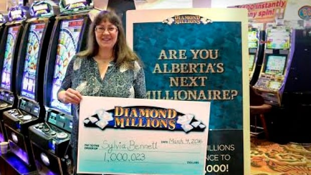 Sylvia Bennett shows off the million-dollar cheque she won playing the slots at River Cree Resort and Casino.