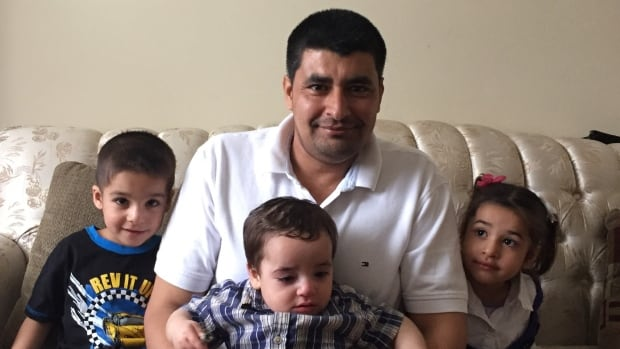 Waleed Alghdyan, his wife Amnah and their six children arrived in Nova Scotia on Jan. 19. He's pictured here with his three youngest children.