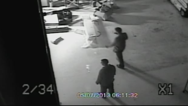 A still image from security video shows two men inside the MillardAir hangar in the early morning hours of May 7, 2013, just hours after Tim Bosma disappeared.