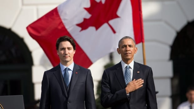 President Barack Obama and Canadian Prime Minister Justin Trudeau, stand for the playing of national anthems during an arrival ceremony on the South Lawn of the White House in Washington.