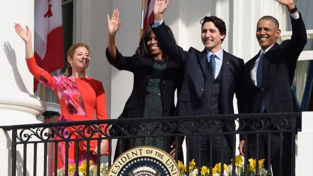 U.S. President Barack Obama, Prime Minister Justin Trudeau, Michelle Obama and Sophie Gregoire-Trudeau wave from the Truman Balcony at the White House in Washington, Thursday.