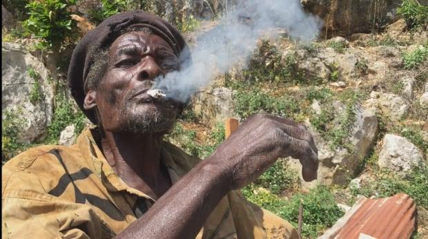 Jamaican smoking marijuana