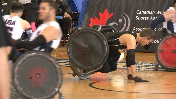 Team B.C. player Cody Fournie takes a fall after a hit during a game against Team USA.