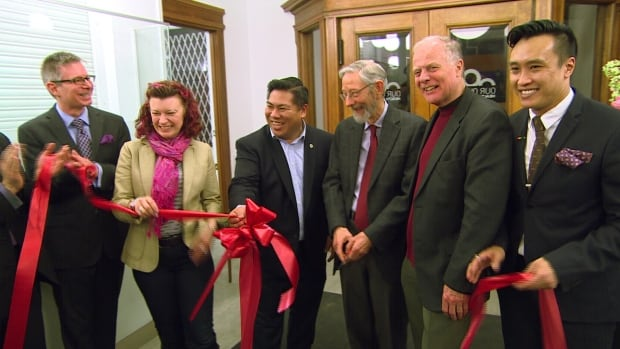 Dr. Bryan Magwood, left, stands beside Manitoba's Minister of Health, Sharon Blady; Mike Pagtakhan, city councillor for Point Douglas and Dr. Dick Smith (centre right) during the ribbon cutting at Our Own Health Centre.
