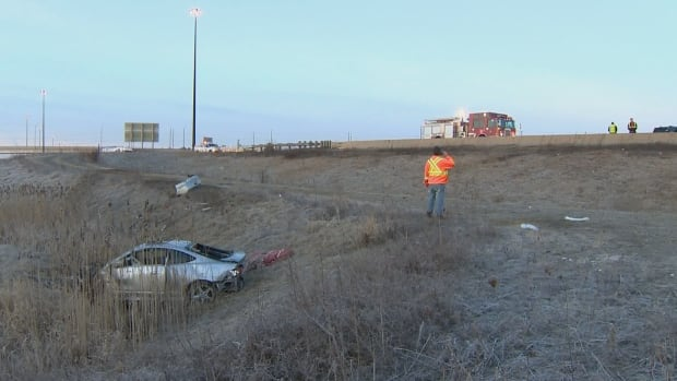 Crews attend a wreck after a car went off Highway 407 near Airport Road in Brampton early on Saturday.