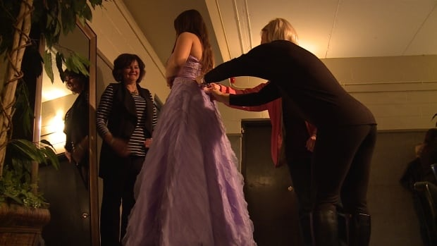 A Miramichi graduate is fitted for a prom dress free of charge at Point Church