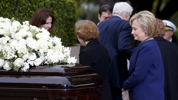 Hillary Clinton pays her respects during the funeral for former first lady Nancy Reagan at the Ronald Reagan Presidential Library in Simi Valley, California on Friday. Clinton came under fire for praising the Reagans' response to HIV/AIDS.