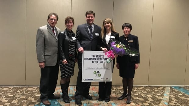 Andrew and Jennifer Lovell receive the Outstanding Young Farmers for Atlantic Region award from the judges at an event in Charlottetown, P.E.I.