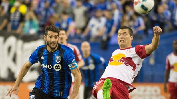 The Impact's Ignacio Piatti, left, challenges the Red Bulls' Karl Ouimette during first-half MLS action in Montreal on Saturday. The Impact prevailed 3-0 at Olympic Stadium to extend its home win streak to eight games. Piatti's goal, his league-leading third of the young season, came in the 71st minute. Dominic Oduro also scored for 2-0-0 Montreal in the 58th minute, the fifth of his career versus New York.