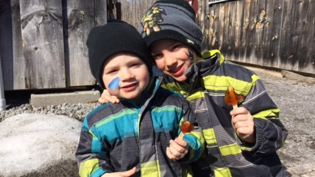 Children enjoy maple candy at Fulton's Pancake House and Sugar Bush on March 12, 2016.