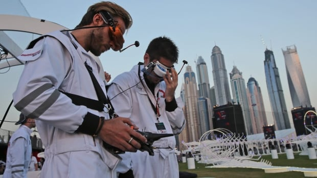 A pilot controls their team drone during the final day of the first World Drone Prix in Dubai, United Arab Emirates.