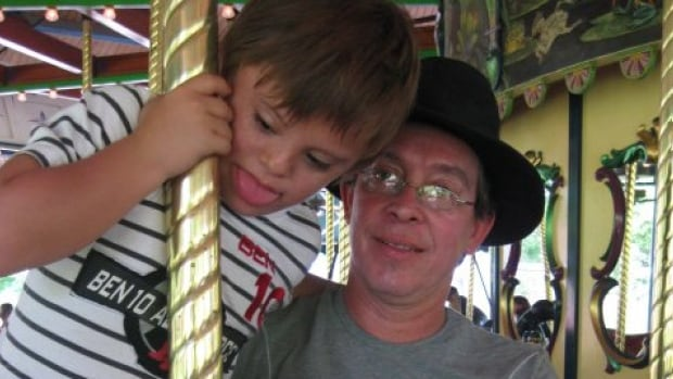 Felipe Montoya (right) must explain to Canadian immigration officials how his family plans to cover health care costs associated with his son Nico (left) who has Down syndrome.