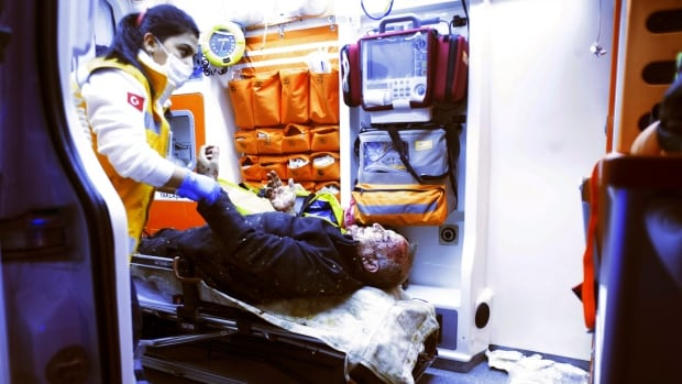A paramedic attends to a person wounded in the Ankara explosion.