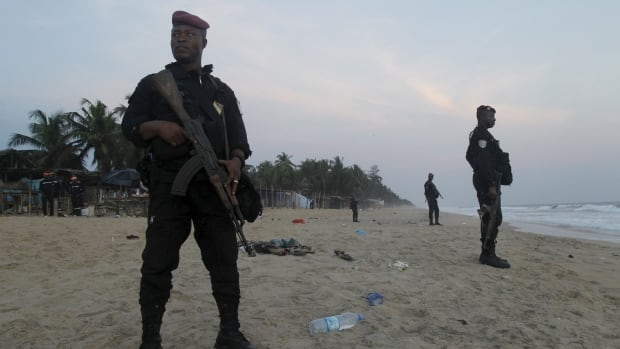 Soldiers stand guard on the beach in Grand-Bassam, Ivory Coast, on Sunday.