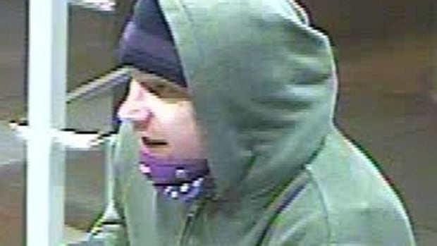 Toronto police are looking for this man, who they allege robbed a woman inside a west end ATM vestibule.