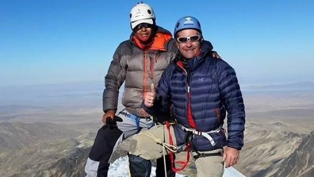 Trevor Stuart and a guide at the summit of Mt. Condoriri in the Bolivian Andes in June 2015.