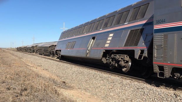 The Amtrak train carrying 131 passengers derailed in rural Kansas moments after an engineer noticed a significant bend in a rail and applied the emergency brakes, an official said.