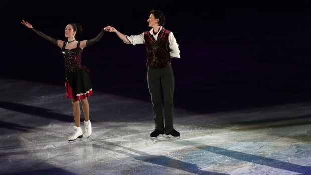 FUKUOKA, JAPAN - DECEMBER 08:  Lorraine McNamara and Quinn Carpenter of the USA wave to the crowd during the victory ceremony for the Junior Ice Dance Free Dance Final on day four of the ISU Grand Prix of Figure Skating Final 2013/2014 at Marine Messe Fukuoka on December 8, 2013 in Fukuoka, Japan.  (Photo by Chris McGrath/Getty Images)