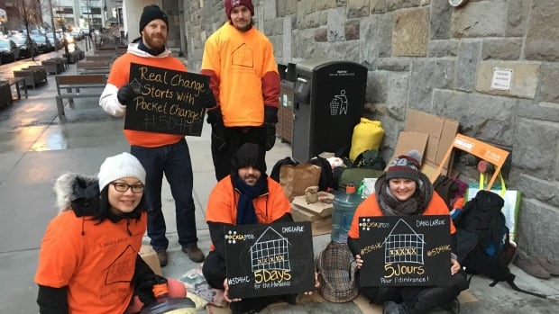Josh Redler and Eric Waldvogel (back row) and Magalie Han (front row, left), Elias Lolei and Emilie Leduc camp outside Concordia University's downtown campus. collecting funds for Chez Doris and Dans la Rue in this year's 5 days for the homeless campaign.
