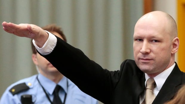 Anders Behring Breivik gestures as he enters a courtroom in Skien, Norway, on Tuesday. Breivik, the right-wing extremist who killed 77 people in bomb and gun attacks in 2011, arrived in court on Tuesday for his human rights case against the Norwegian government.