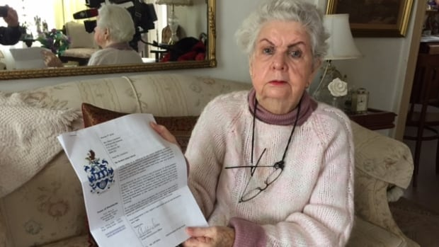 Maria Cameron holds the letter sent to her by the Town of Stewiacke. She's battling the town over flooding on her property that started soon after town staff repaired a fire hydrant on the street near her home.