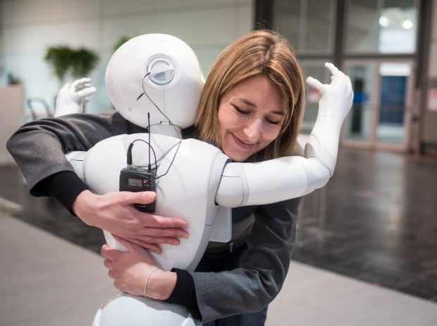 GERMANY CeBIT TECH FAIR SoftBank robot Pepper hug March 13 2016