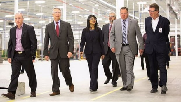 Guelph MP Lloyd Longfield (second from left) and Waterloo MP and Minister of Small Business and Tourism Bardish Chagger (middle) tour Hammond Manufacturing in Guelph ahead of a funding announcement.