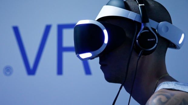 A visitor plays a game on a PlayStation VR at the Paris Games Week on Oct. 28, 2015.