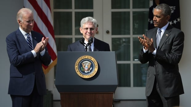 U.S. President Barack Obama, right, and Vice President Joe Biden, left, stand with judge Merrick B. Garland while nominating him to the U.S. Supreme Court, in the Rose Garden at the White House on Wednesday.
