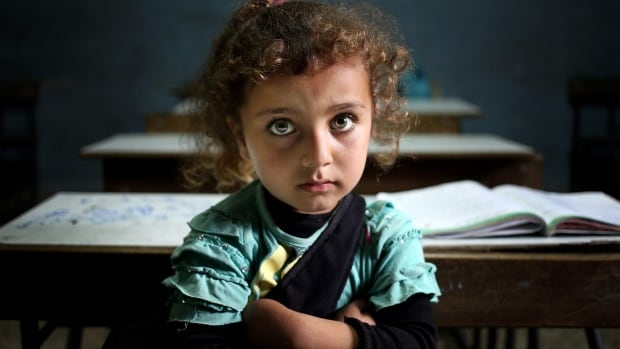 A Syrian refugee girl sits in a classroom at a Lebanese public school.