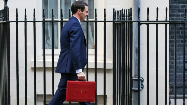 Britain's Chancellor of the Exchequer George Osborne carries the traditional red dispatch box with the budget outside 11 Downing Street in London. 11 Downing Street, right next door to the prime minister, is the official residence of the chancellor.