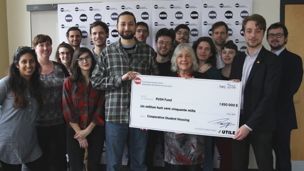 Members of UTILE and CSU stand with the 1.85 million dollar PUSH fund cheque, which was extracted from Concordia students' tuitions as a fee-levy.