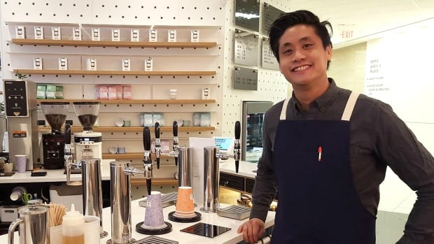 Monogram Coffee owner Jeremy Ho stands in front of his 'honour bar' at the cafe's new downtown location.