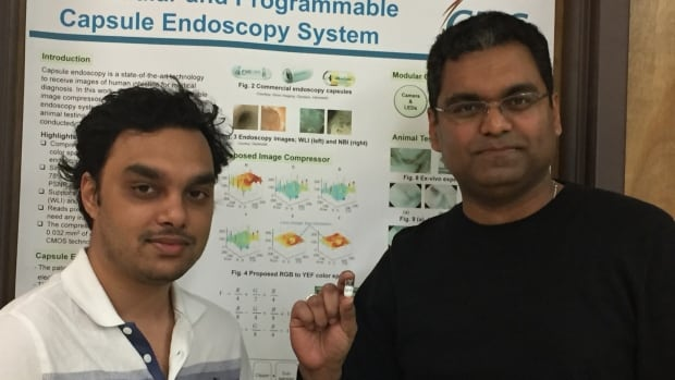 University of Saskatchewan researcher Khan Wahid holding the tiny camera pill with a university student Shahed Khan Mohammed.