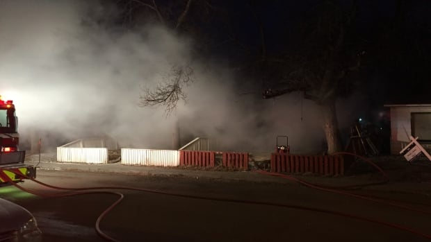 Smoke was billowing from the home on King Street Thursday morning.