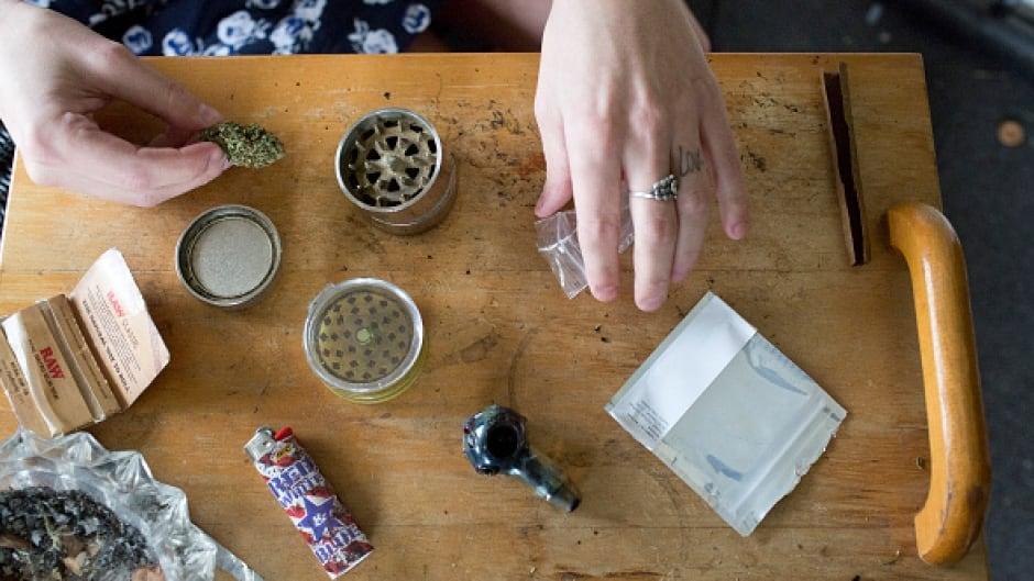 Air Force Amy Rising grinds up medical marijuana before smoking.