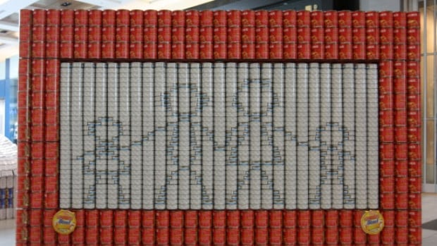 This is IDC's 2016 Canstruction entry - a two-sided Etch-A-Sketch made of 2,950 cans of food.