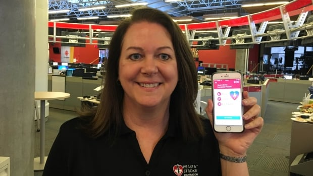 "Shelley Parker shows off the Heart & Stroke Foundation's new CPR training app, ""Call. Push. Restart."""