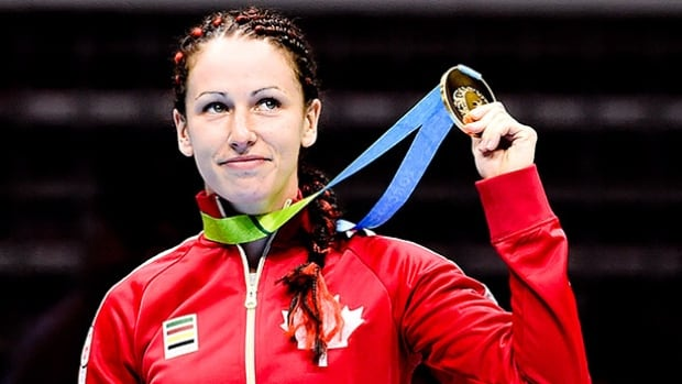 Canada's Mandy Bujold, seen here showing off her Pan Am Games gold medals, secured an Olympic berth Thursday at the 2016 American qualification event in Buenos Aires.
