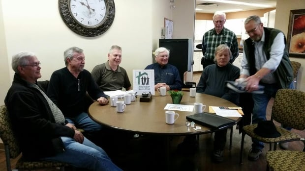 Some of the members of the Okanagan Men's Shed gather for coffee at the Hawthorn Park Retirement Home.