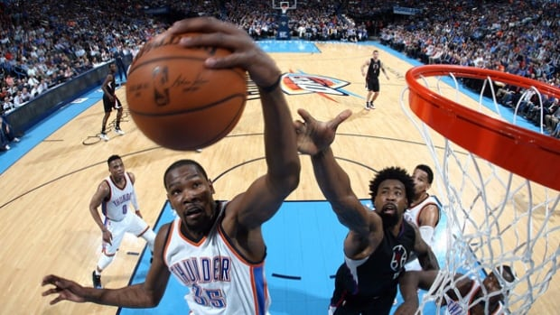 The NBA and NBA Players Association reportedly have agreed to shorten this summer's free-agent moratorium by five days. New deals struck this summer may now be signed on July 7 at 12:01 a.m. ET. The Thunder's Kevin Durant, left, is one of several players that could be on the move.