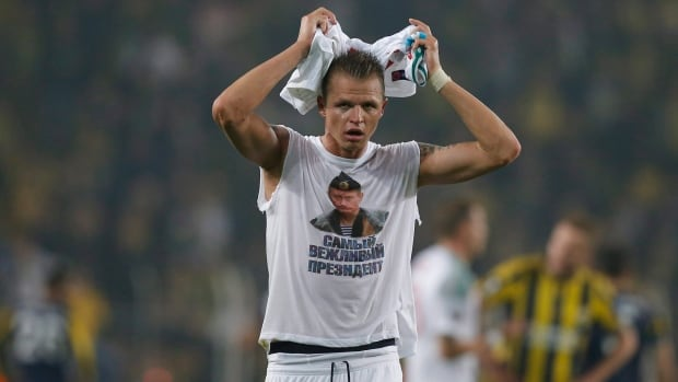 """Locomotiv Moscow's Dmitri Tarasov features an inner shirt with a picture of Russian President Vladimir Putin and the slogan """"The most polite President,"""" following a Europa League match against Fenerbahce in Istanbul on Feb. 16, 2016."""