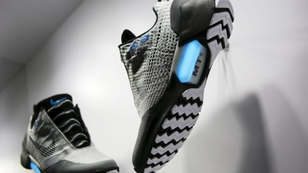 Nike HyperAdapt 1.0 sneakers automatically tighten when you step in and your heel hits a sensor. There are two buttons on the side to tighten and loosen the fit.